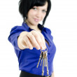Portrait of a business woman holding keys. Focused on keys. Isolated on whi — Stock Photo #8653494
