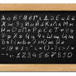 Chalkboard with Russian alphabet letters, numbers and symbols for your own — Stock Photo