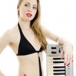 Woman in black swimsuit posing with Piano keyboard. Isolated on white. — Stock Photo