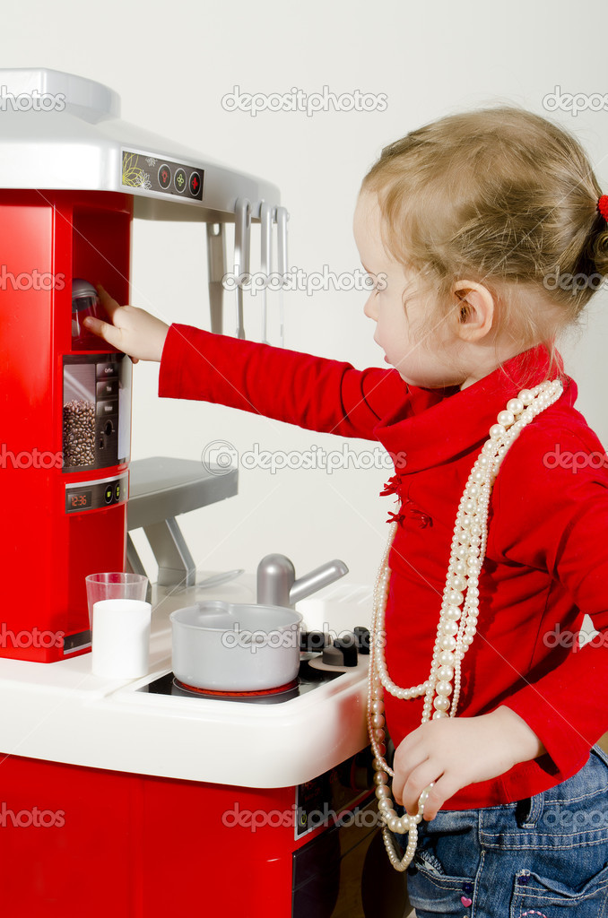 Little cute girl playing in children's kitchen. — Stock Photo #9271904