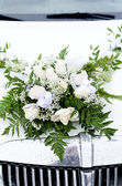 Bridal bouquet on the Car hood — Stock Photo