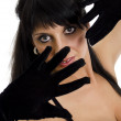 Seductive woman in black lingerie with gloves. Isolated on white. — Stock Photo