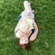 Happy family. Mother and daughter lying on grass. — Stock Photo #9767411