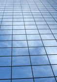 Modern office building with blue square windows. — Stockfoto