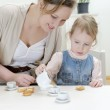 Mom and daughter having tea with bagels — Stock Photo #9806627