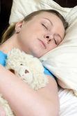 Young girl fell asleep with teddy bear — 图库照片