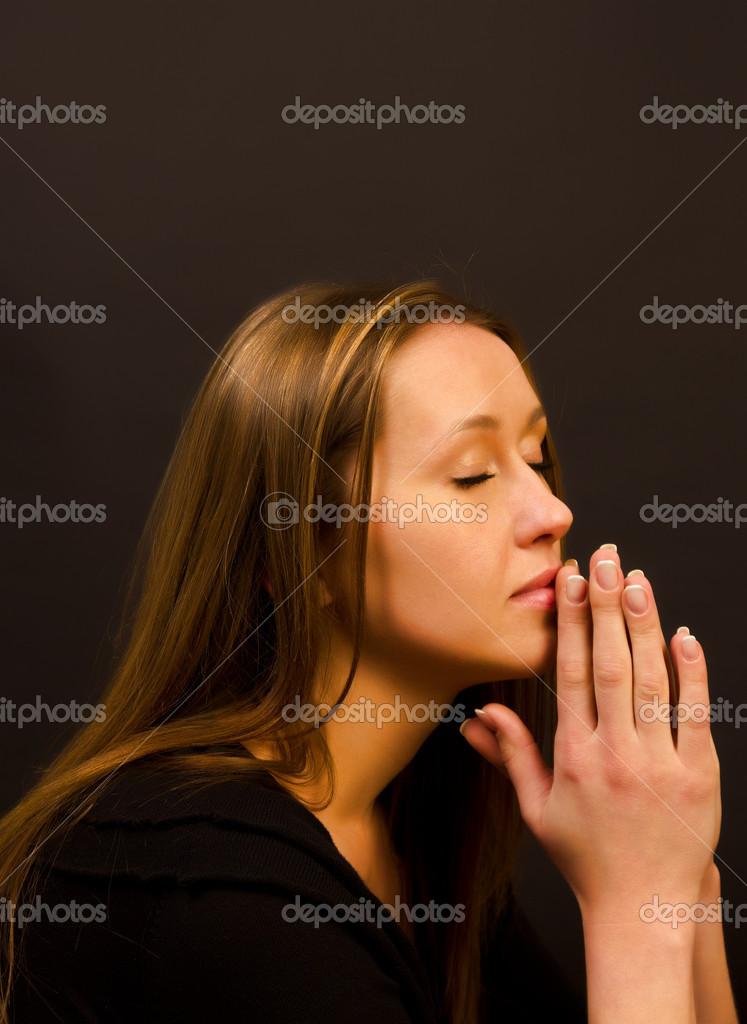 Woman praying — Stok fotoğraf #10139064