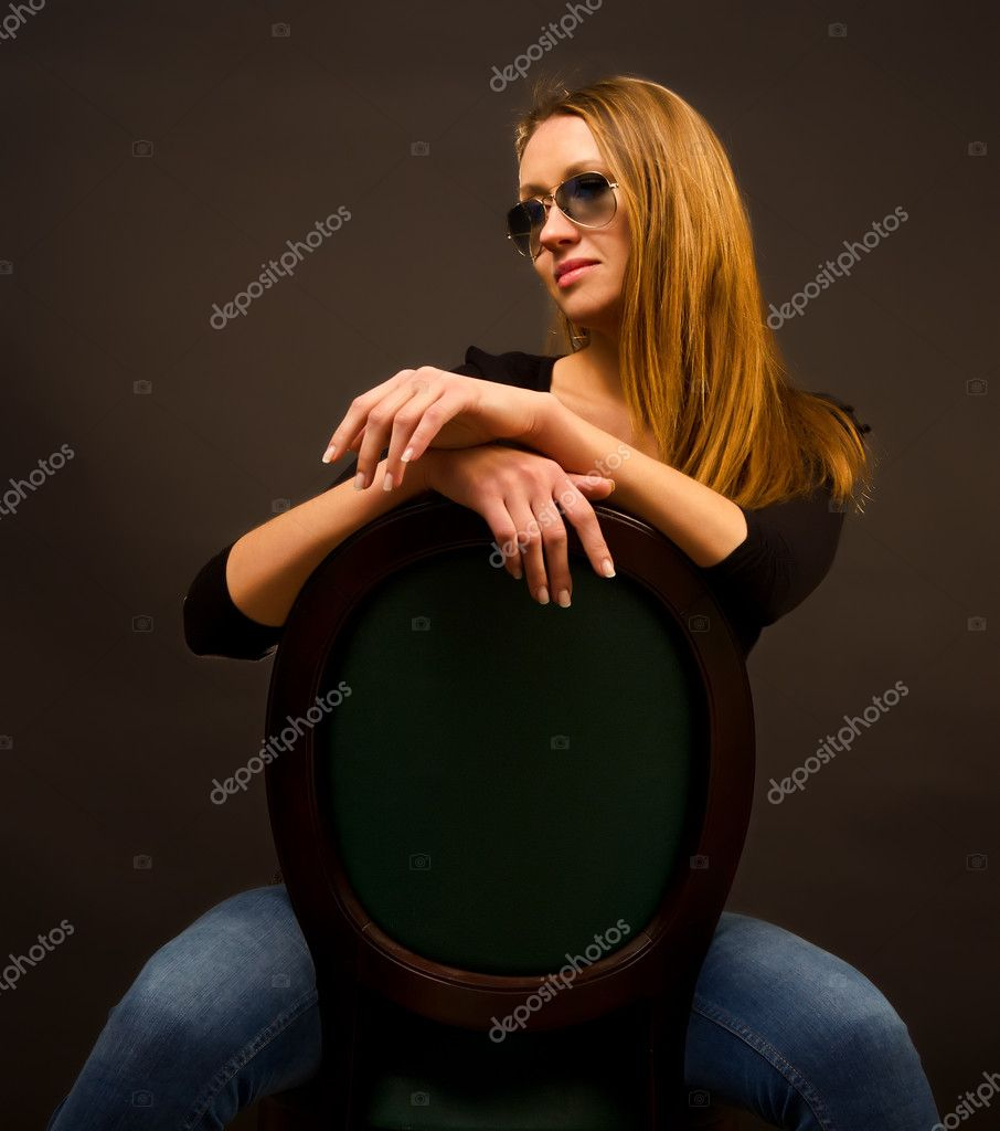 Sexy girl sitting on a chair  Stock Photo #10280170