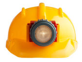 Construction helmet with a flashlight — Stock Photo