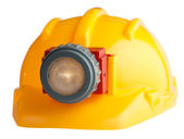 Construction helmet with a flashlight — Foto de Stock