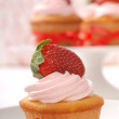 Delicious Vanilla cupcake with strawberry frosting — Stock Photo