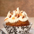 Delicious carrot cake cupcake with cream cheese frosting and nut — Stock Photo #8879217