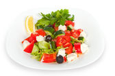 Fresh Greek salad in white bowl — Stock Photo