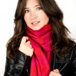 Portrait of young woman wearing black jacked and red scarf — Stock Photo #10076203