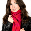Stock Photo: Portrait of young womwearing black jacked and red scarf
