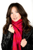 Portrait of young woman wearing black jacked and red scarf — Stock Photo