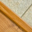 Wooden and tile floor — Stock Photo