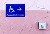 Handicap entrance sign and button — Стоковое фото
