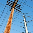 Wooden utility pole with power lines — Stock Photo