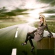 Beautiful blond woman with suitcase — Stock Photo #10352958