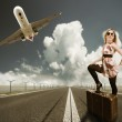 Beautiful blond woman with suitcase — Stock Photo #10352962