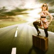 Beautiful blond woman with suitcase — Stock Photo #10352976