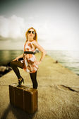 Beautiful blond woman with suitcase — Stock Photo