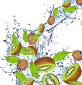 Kiwis in splash — Stock Photo