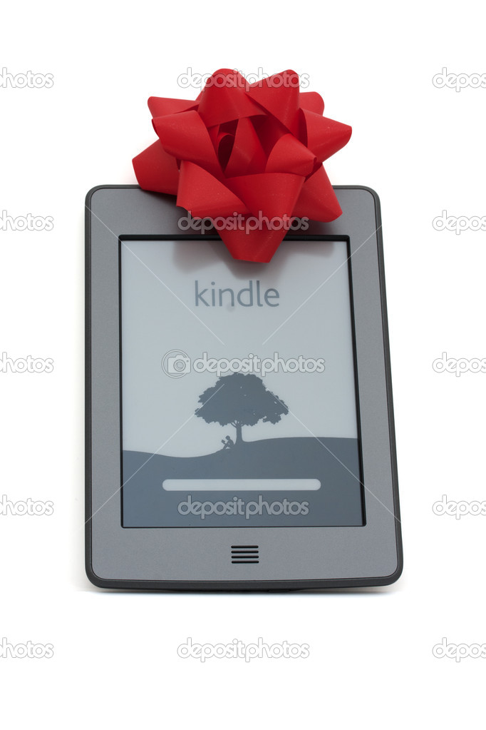 A kindle touch e-reader with a silver bow isolated on white  Stock Photo #8057256