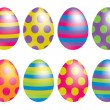 Bright spotty and striped Easter eggs in vector format. — Stock Vector #10308648
