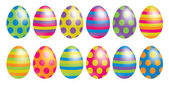 Bright spotty and striped Easter eggs in vector format. — Stock Vector