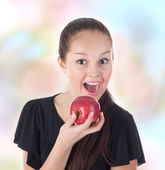 Teenager fun eating a red apple — Stock Photo