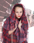 Young woman in the hood in the old style — Stock Photo