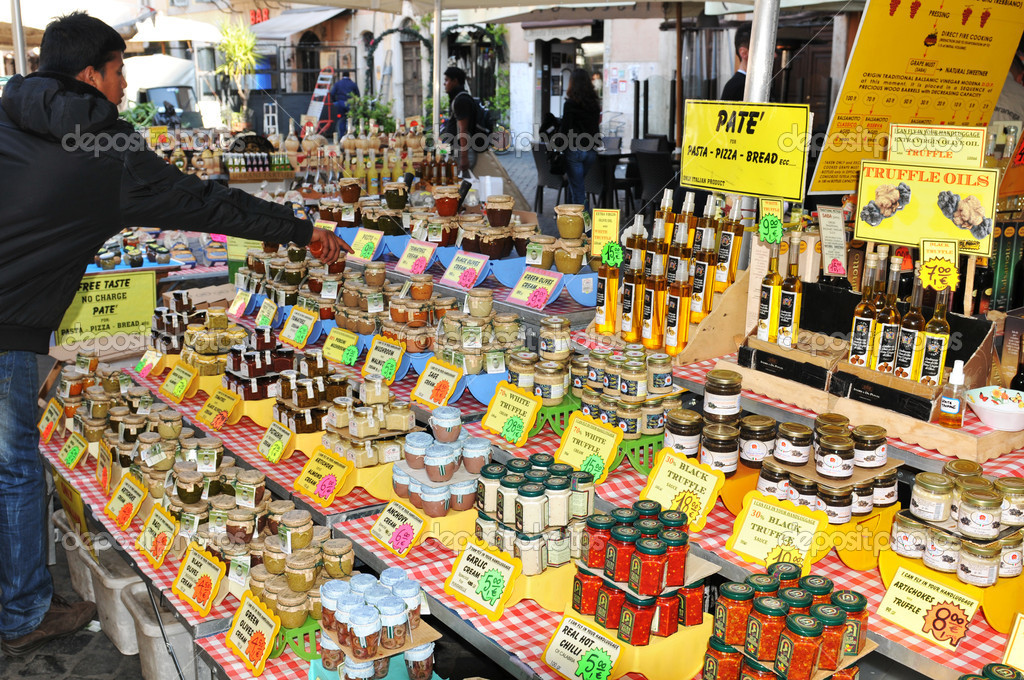 Rome, Italy - 28 March, 2012: Traditional Italian products for sale in Campo de Fiori, famous outdoor market in central Rome — Stock Photo #10264438