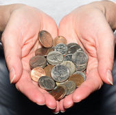 Hands holding assorted change — Stock Photo
