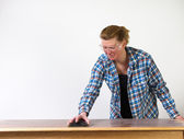 Re-finishing a table — Stock Photo