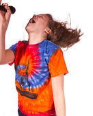 Teen Girl singing in a microphone — Stock Photo