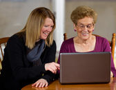 Daughter teaching elderly mother — Stock Photo
