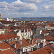 Over red roofs of Lisbon — Stock Photo