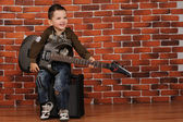 Boy with electric guitar — Stock Photo