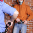 Police officer arrested robber with revolver — Stock Photo