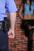 Police officer delay prostitute — Stock Photo