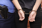 Girl in handcuffs — Stock Photo
