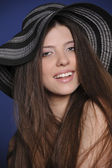 Girl in big hat — Stock Photo