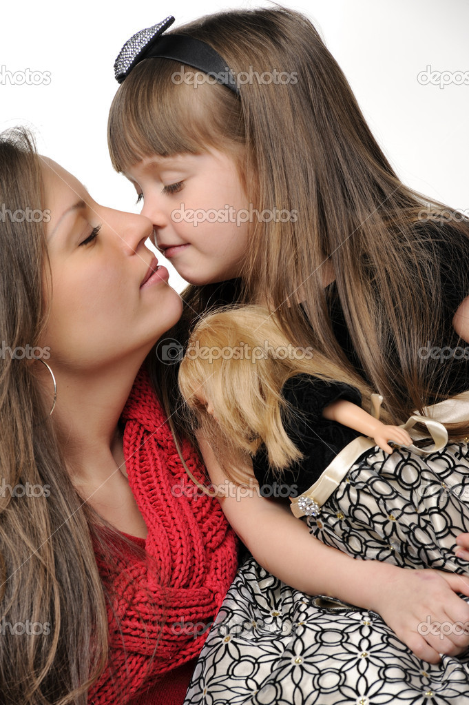 Mother kiss her little daughter — Foto de Stock   #9140261