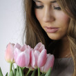 Girl with pink tulips — Stock Photo