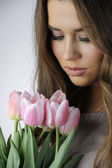 Girl with pink tulips — Stok fotoğraf