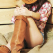 Stock Photo: Sleeping cowgirl