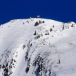 Stock Photo: Skiing Down Snowy Granite Mountain from Lookout Tower Snoqualme