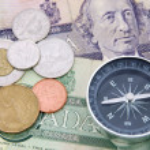 Compass on canadian dollar — Stock Photo
